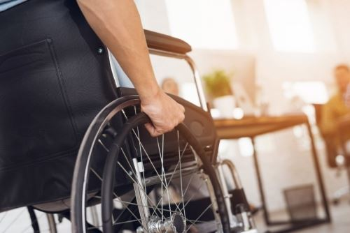 low-angle photo of a person in a wheelchair